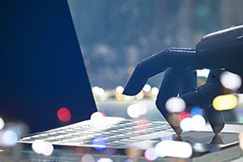 Robot Types On Laptop