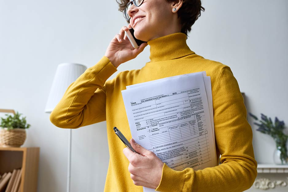 Woman Smiling And Holding Form 1040A