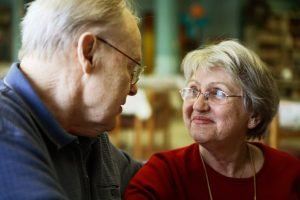 Elderly couple gazing into each other's eyes