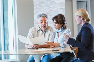 Middle-Aged Couple With Financial Advisor